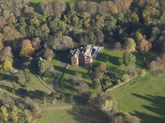 Oblique aerial view centred on the tower house/country house, taken from the W.