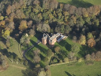 Oblique aerial view centred on the tower house/country house, taken from the SW.