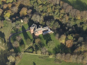 Oblique aerial view centred on the tower house/country house, taken from the SSW.