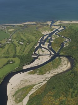 General oblique aerial view of the mouth of the River Spey centred on the Spey viaduct with the Garmouth and Kingston Golf Course beyond, taken from the S.