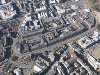 General oblique aerial view centred on the mills of Lochee Road taken from the ESE.