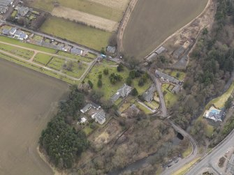 Oblique aerial view centred on the kirk with the burial ground adjacent, taken from the NE.