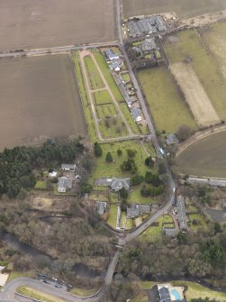 Oblique aerial view centred on the kirk with the burial ground adjacent, taken from the NNW.