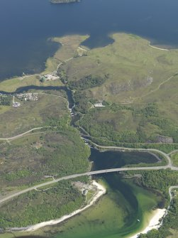 Oblique aerial view looking along the River Morar across the bridges, taken from the W.