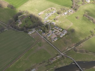 Oblique aerial view centred on the village, taken from the S.