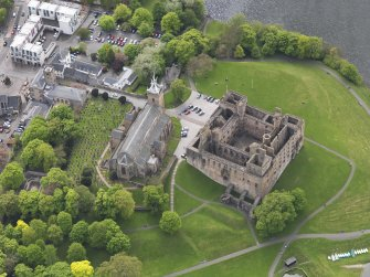 Oblique aerial view centred on the Palace with the parish church adjacent, taken from the NE.