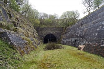 View from SSE showing tunnel mouth and retaining walls at entrance.