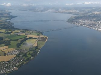 General oblique aerial view lookings along the Firth of Tay with the bridges and Dundee in the distance, taken from the NE.