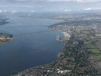 General oblique aerial view lookings along the Firth of Tay towards the bridges and Dundee, taken from the NE.
