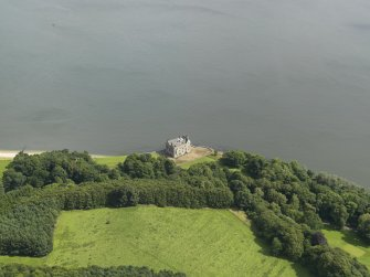 General oblique aerial view of Barnbougle castle, taken from the SW.