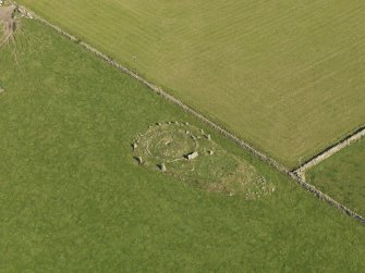 Oblique aerial view of the remains of the recumbent stone circle at Aquhorthies, taken from the SW.