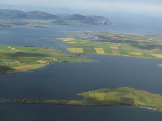 General oblique aerial view across the Loch of Harray with the Ring of Brodgar in the foreground and Hoy beyond, taken from the NE.