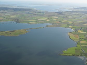 General oblique view of the Loch of Stenness with the Ring of Brodgar to the left, taken from the SW.