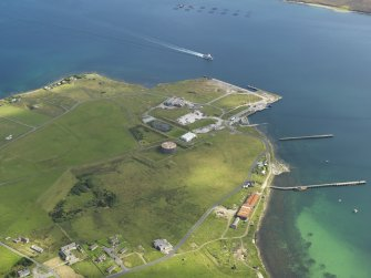Oblique aerial view centred on the Royal Naval Oil Terminal at Lyness, taken from the SW.
