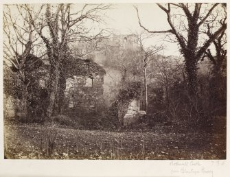Page 7/5. Distant view of Bothwell Castle, from Blantyre Priory. Titled 'Bothwell Castle from Blantyre Priory.' PHOTOGRAPH ALBUM 146: THE ANNAN ALBUM Page 7/5