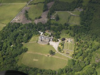 Oblique aerial view of Castle Toward country house and policies, taken from the S.