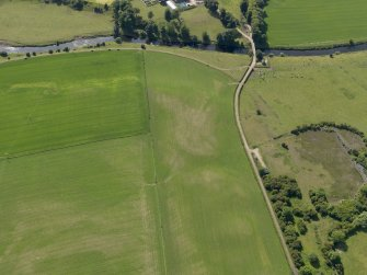 Oblique aerial view of the parchmarks of the round house at Holms, taken from the ESE.