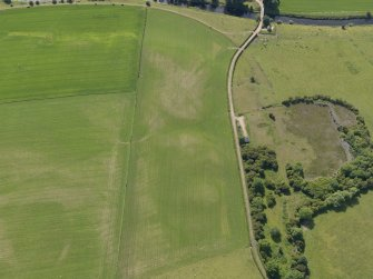 Oblique aerial view of the parchmarks of the round house at Holms, taken from the E.