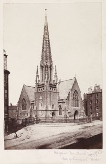 Page 26v/4Glasgow, 165 Duke Street, Well Park Free Church. General view of church from South-West showing earlier Gothic style tower. Titled 'Wellpark Free Church, 983, (1854) Hay of Liverpool. archit.' PHOTOGRAPH ALBUM: 146: THE  THOMAS ANNAN ALBUM.