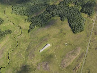 Oblique aerial view of Camster Long chambered cairn and the adjacent sheepfold, taken from the SE.