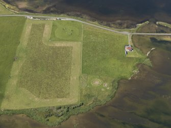 Oblique aerial view of the excavations at the Ness of Brodgar, taken from the ENE.