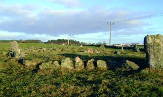 The kerbstones of the cairn on the SW and the link with the recumbent setting