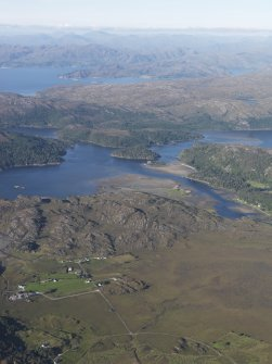 General oblique aerial view of An Fhashaid Dhubh with Castle Tioram, Loch Moidart and Loch Ailort beyond, looking NNE.