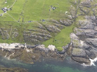 Oblique aerial view of Dun Beag, Vaul, Tiree, looking to the W.