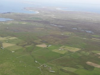 General oblique aerial view of Balevullin and Kilmoluaig on Tiree, looking to the ENE.