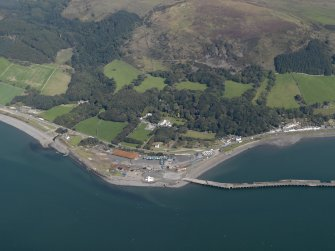 Oblique aerial view of the pier at Cairnryan and Lochryan country house, taken from the WSW.