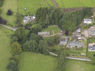 General oblique aerial view of the village centred on the church taken from the S.