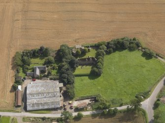 Oblique aerial view of the castle and farmhouse taken from the N.