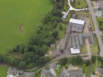 General oblique aerial view of the Tealing Home Farm centred on the dovecot taken from the SSE.