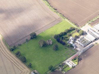 General oblique aerial view of Braikie Farm, centred on  Braikie Castle, taken from the E.