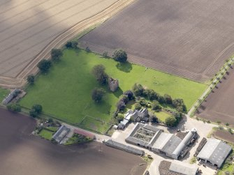 General oblique aerial view of Braikie Farm, centred on  Braikie Castle, taken from the NNE.