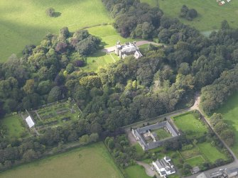 General oblique aerial view of the Dunninald estate, centred on Dunninald Castle, taken from the E.
