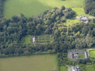 General oblique aerial view of the Dunninald estate, centred on Dunninald Castle, taken from the ENE.