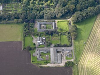 General oblique aerial view of the Dunninald estate, centred on Dunninald Mains Farmhouse,  taken from the E.