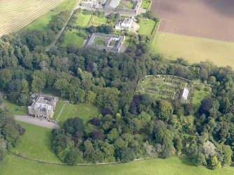 General oblique aerial view of the Dunninald estate, centred on Dunninald Castle, taken from the SW.