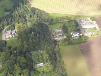 General oblique aerial view of the Dunninald estate, centred on Dunninald Castle, taken from the NE.