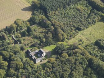 General oblique aerial view of Kintrockat House estate, centred on Kintrockat House, taken from the WNW.
