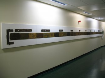 View of 'Narratives' ('The Bed Plaque Project'), along wall of N corridor on first floor.