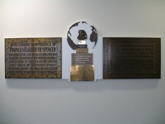 View of 'Nursing' (The Bed Plaque Project'), along wall of N corridor on first floor.