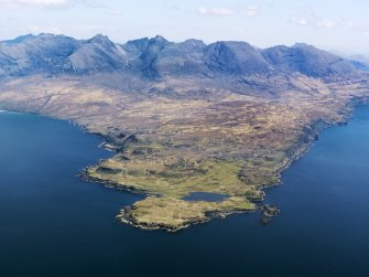 General oblique aerial view centred on Loch na h-Airde, the 'Viking Canal' and Rubh' an Dunain with the Cuillin Hills in the background, taken from the WSW.