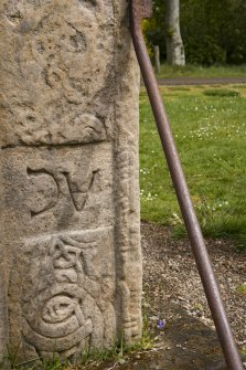 Detail of ogham inscription on right hand side of front face of the Rodney Stone (daylight)