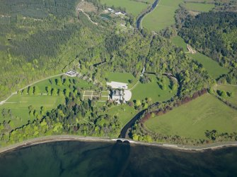 Oblique aerial view of Inveraray castle looking over the Aray Bridge, taken from the ESE.