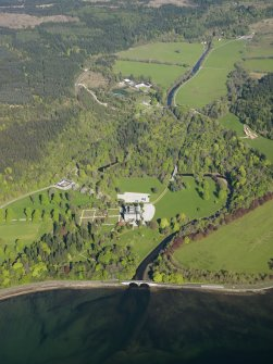 Oblique aerial view of Inveraray castle looking over the Aray Bridge, taken from the SE.