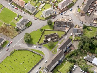 Oblique aerial view of Maybole, centred on St Mary's Church, taken from the NNE.