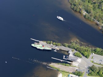 General oblique aerial view of Balloch Pier, taken from the SSW.
