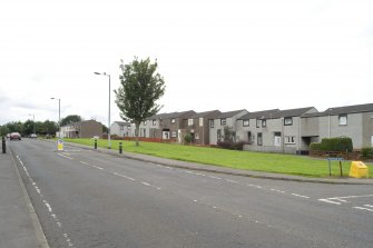Street view showing terraced housing at 2-18 Redbrae Avenue, Bo'ness, taken from Gauze Road to the North-East. This photograph was taken as part of the Bo'ness Urban Survey to illustrate the character of the Hillcrest and Brewlands Area of Townscape Character.